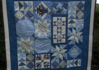 A lap quilt, which my cat Duchess has taken for her own!