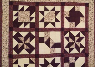 A sampler quilt in brown and cream