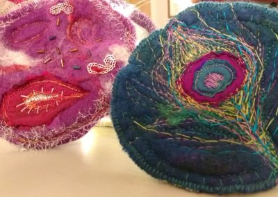 Felt and stitched roundal